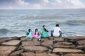 Indian family near the ocean — Stock Photo
