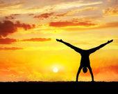 Yoga handstand silhouette — Stock Photo