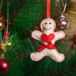 Christmas tree with gingerbread man — Stock Photo