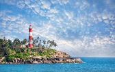 Lighthouse on the rocks — Stock Photo