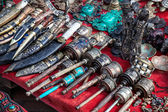 Prayer wheels and Nepali knives  — Stock Photo