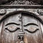 Wooden door with eyes — Stock Photo