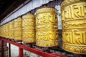Golden prayer wheels — Stock Photo