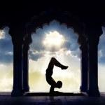 Yoga silhouette in temple — Stock Photo #51006965