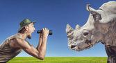 Tourist and Rhino — Stock Photo