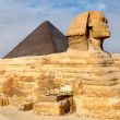 View of the Sphinx and Pyramid of Khafre, Cairo, Egypt - Stock Photo