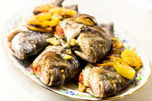 Grilled seabass with vegetables, herbs and lemon on a dish — Stock Photo