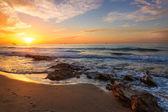 Beautiful sunset on the beach — Stock Photo