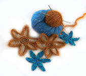 Crocheted flowers made of artificial and natural yarn — Stock Photo