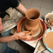 Potter, creating an earthen jar on the circle - Stock Photo