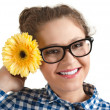 Portrait of attractive girl in glasses with flower — Stock Photo