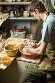 Potter, creating an earthen jar of white clay — Stock Photo