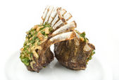 Lamb lion with thyme elegantly served on a white background isolated — Stock Photo