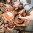 Potter at work - Stock Photo