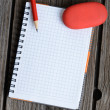 Notebook, pencil and eraser — Stock Photo