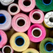 Colorful reels of threads background — Stock Photo