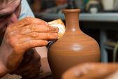 Hands of a potter, creating an earthen jar — Stockfoto