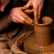 Stock Photo: Hands of potter, creating earthen jar