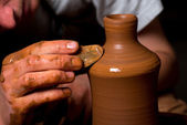 Hands of a potter, creating an earthen jar — Stock Photo