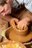 Hands of a potter, creating an earthen jar — Fotografia Stock