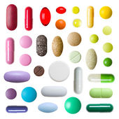 Colorful pills isolated on white background — Stok fotoğraf