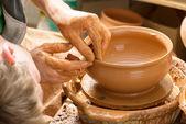 Hands of a potter, creating an earthen jar — Stock Photo