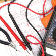 Stock Photo: Digital multimeter and electronic circuitry