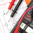 Digital multimeter and electronic circuitry — Stock Photo #13947279