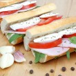 Fresh sandwiches with tomato , ham and mozzarella isolated on wh — Stock Photo