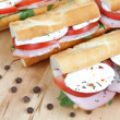 Three fresh sandwiches with tomato , ham and mozzarella — Stock fotografie