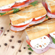 Three fresh sandwiches with tomato , ham and mozzarella — Stock Photo