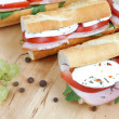 Closeup of three fresh sandwiches with tomato , ham and mozzarel — Stock Photo