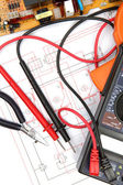 Digital multimeter and electronic circuitry — Stock Photo