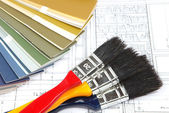 Tools and accessories for home renovation on an architectural drawing — Stockfoto