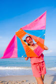Girl in dress with sunglasses on the sea beach with kite have jo — Stock Photo