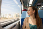 Girl looking out the window in a subway train — Stock Photo