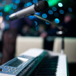 Microphone and piano — Stock Photo #4655112