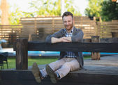 Portrait of handsome young man smiling outdoors — Stock Photo