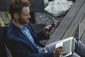 Handsome businessman working with laptop — Stock Photo