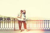Happy and young pregnant couple hugging in nature at the lake. V — Foto de Stock