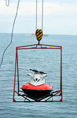Jet ski lift for dry storage on the sea background — Stock Photo