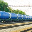 Railroad tank car with olil - ストック写真