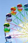 Ferris wheel on the blue sky background — Stockfoto