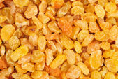 Golden raisins close- up food background — Stock Photo