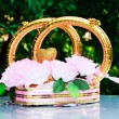 Stock Photo: Golden rings and flowers as wed car decoration