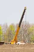 Crane working on the oil and gas fields — Stock Photo