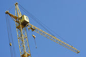 Tower crane on blue sky background — Stock Photo