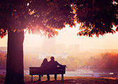 Romantic Couple on a Bench by the River — Stok fotoğraf