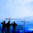 Builders against the background construction — Stock Photo