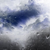 Clouds through the wet glass — Stock Photo